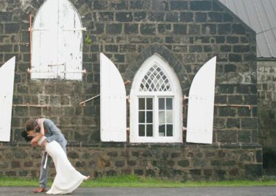 Bride and groom in front the church