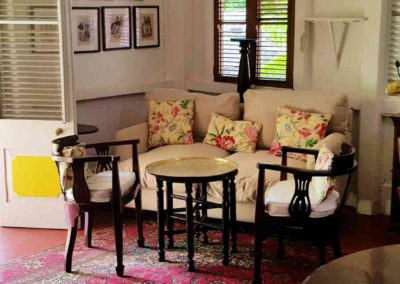 Comfortable sofa and antique chairs